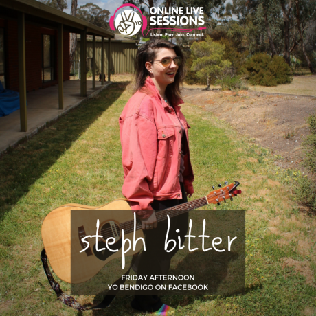 "Steph Bitter holding a guitar and standing on a lawn, wearing sunglasses and a pink jacket, smiling off-camera. Top of the picture shows the YO Online Live Sessions logo, bottom of the photo is labelled ""Steph Bitter, Friday afternoon, YO Bendigo Facebook"""