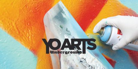 A banner image with text saying YO Arts Underground on top of a background image of someone spray painting a mural on a wall