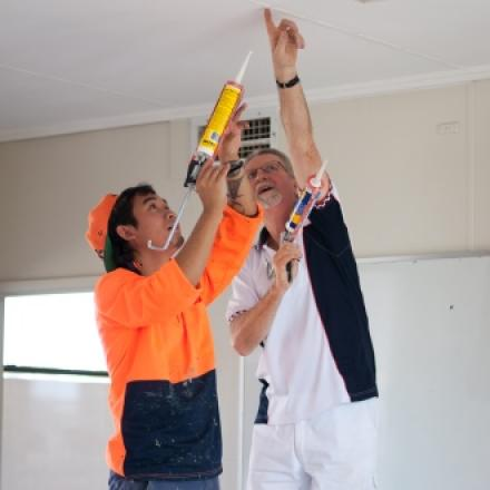 2 tradies working on a ceiling